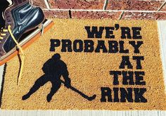 """We're probably at the rink"""" HAND PAINTED door mat. *original design* Size: 18x30 Material: 100% coir with a vinyl back Other materials: Enamel, UV protectant, Sealer. Care: Shake mat, spot clean. Coir/Coconut is a renewable material - this mat should last you many laughs and seasons!"""