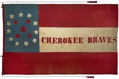 "This flag was carried by Colonel Stand Watie's Cherokee Mounted Rifles; the body of the flag is the First National pattern flag of the Confederate States; the canton is blue with eleven white stars in a circle, surrounding five red stars representing the Five Civilized Tribes (Cherokee, Creek, Choctaw, Chickasaw and Seminole); the large red star in the center represents the Cherokee Nation. ""Cherokee Braves"" is lettered in red in the center of the white stripe.  From the Trans Mississippi Mu..."