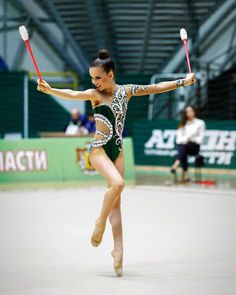 Image may contain: 1 person Rhythmic Gymnastics Costumes, Gymnastics Suits, Gymnastics Girls, Baton Twirling Costumes, Dance Costumes, Green Leotard, Synchronized Swimming, Swimsuit Pattern, Artistic Gymnastics