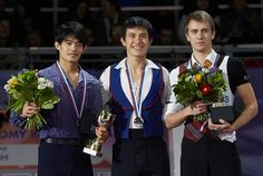 MOSCOW, RUSSIA - NOVEMBER 011: The winners of the men competition from left to right are, Silver medalist from Japan Takahiko Kozuka, Gold metalist from Canada Patrick Chan, Bronze metalist from Czechia Michal Brezina all stand together holding their medals during ISU Rostelecom Cup of Figure Skating 2012 at the Megasport Sports Center on November 11, 2012 in Moscow, Russia.
