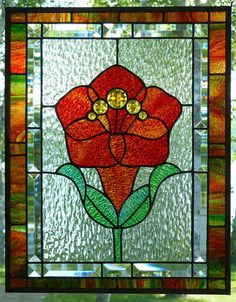 A glazing and vivid stained glass flower by SaraFranceGlassArt
