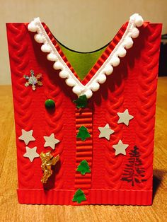 Ugly Sweater Card.  I love this card!!! This a card with a lot of options. We made it at Stamp Camp October 23, 2016. Stampin' Up! Cable knit dynamic textured impressions embossing folder, Crimper, Greetings From Santa stamp set, pom-pom trim, Real Red card stock, Old Olive card stock, multipurpose glue.