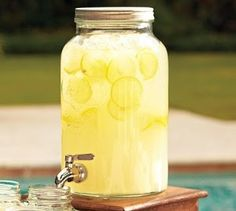 Mason Drink Dispenser at Pottery Barn 2 cups CountryTime Lemonade mix, chilled Pineapple Juice, 1 Liter chilled Sprite, 2 cups cold water, lemon slices and ice: Mason Jar Drink Dispenser, Mason Jar Drinks, Beverage Dispenser, Juice Dispenser, Glass Dispenser, Party Drinks, Fun Drinks, Yummy Drinks, Summer Beverages
