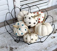 Small white pumpkins are easy to decorate. I used upholstery tacks and wall protectors to decorate several pumpkins. They look great displayed in a group. #pumpkins #white @rustoleum