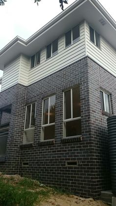 Surfmist windows, eaves, fascia, gutters, Basalt gutters, ballustrade and rain tanks, Blue Flash Steel Bricks, Exterior House Colors, Exterior Design, Facade House, House Facades, Window Frame Colours, Brown Brick Houses, Rawson Homes, Double Storey House, Dark House