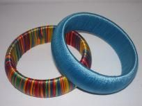 Beautiful Multi-colored and teal bangle bracelets with embroidery thread wrapped around them. Adult size bangles. Great Quality!! This is the spring/summer fashion tread of the year!  If you would prefer to have a pink or purple bangle instead of a teal one just message me and I can switch them out.$7.50+FREE SHIPPING