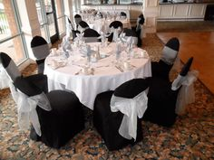 Black Chair Covers available for rent with Silver Organza Bows in Silverado - Special Event Linens