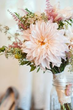 Lace Trimmed Cafe Au Lait Dahlia Bouquet - Dahlias are a full, round flower that look beautiful when paired with poppy pods, lilies and virtually any other flower. They're amazing enough to have in a bouquet or arrangement all alone, but look great paired with tiny, cluster-like flowers.