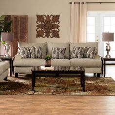 The Trinidad Room Package includes a sofa, loveseat, cocktail table, 2 end tables and 2 lamps. Built on an oversized frame with transitional styling, elegant chenille fabrics and 6.5 inches of premium foam cushioning this generously sized, delightfully comfortable sofa is definitely nap-worthy. E...