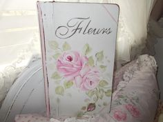 Hand painted roses on Vintage records book.