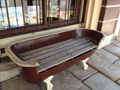 Repurposed bathtub become a bench seat.