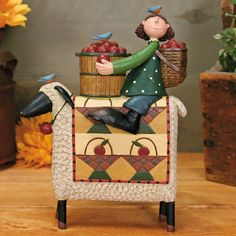 Girl Sitting on a Sheep with Basket full of Apples Figurine - $46.00