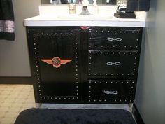 Harley Bathroom Vanity. Harley Bathroom.. Repainted the existing wood vanity and added upholstery tacks.