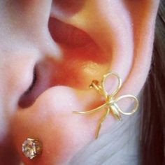 Conch piercing with cute bow jewelry