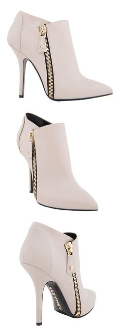 Pale high heels with zipper. Latest shoes fashion trends 2015.