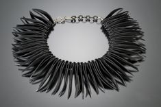 good craft project.  Recycled rubber tire necklace