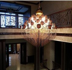 Sibilla Collection Handmade customized iron chandelier with jewel tassels- metal shades with Swarovski Crystals and brown tissue shade #eurolampart #luxurylight #lighting #luxuryhome #homecollection