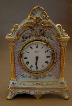 Hand painted 8 inch Beautiful porcelain Clock Gold trimed, Floral sprays of Roses