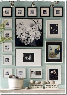 mix of both black and white frames and mats. Love.