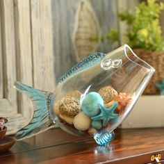 This fish-shaped bowl with blue finish fins is so fun and perfect for coastal decor! Fill it with shells, stones or other beach trinkets. Make it a centerpiece on your table or an accent piece on your bookshelf.