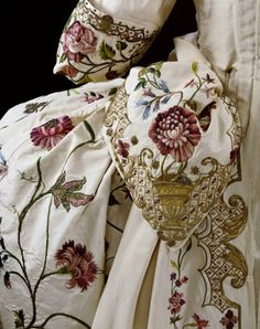 Detail of a mantua, England, 1740-1745, embroidered silk with coloured silk and metal threads, Victoria and Albert Museum