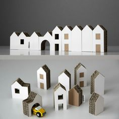 New! Set of Nine Small Cardboard Houses I'm imagining these in a travel box with a couple small cars and maybe some tiny people. ;)