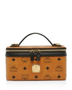Shop the Rockstar Vanity Case in Visetos Original at MCM. This chic vanity  case comes in monogram Visetos with a natural leather handle. 63eb13f626f7