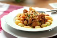 "Pork Geschnetzeltes with Gnocchi - A German ""goulash"" made with marinated pork tenderloin and onions."