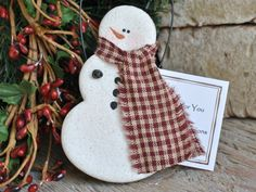 This handcrafted salt dough snowman is an all-time favorite!! He's the warm white color of the dough with hand painted snowman details. Scarf is a real fabric piece of homespun in red or blue (exact p