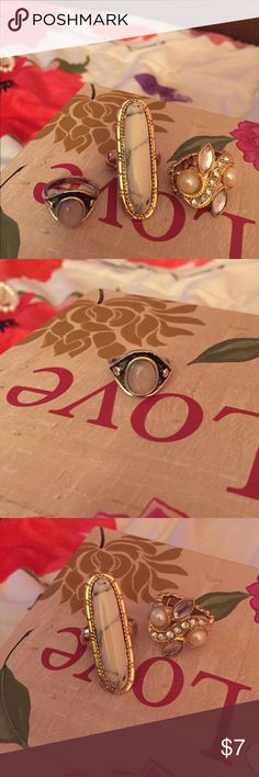 2 Gold Stretchy Rings and 1 Silver Ring (size 8) 2 gold Stretchy rings and 1 silver ring, all still in good condition! Gold stretchy ring ( with large white detailing) gently used, shows some signs of wear, other gold ring worn once! Silver ring (size 8) gently used, still in great condition! Jewelry Rings