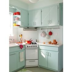 Another cute light blue w/ red kitchen...trying to figure out how to work with the light blue kitchen counter tops in the house we might *hopefully* buy. I think the pops of bright color make it more modern :)