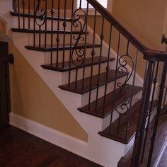 white trim with dark wood stairs