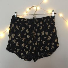 Brandy Melville sunflower dolphin shorts Cute shorts with side pockets and a draw string. Perfect condition. Not too short on me (and I'm a size 8). Brandy Melville Shorts Skorts