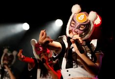 """Members of Japan's idol group """"Virtual Currency Girls"""" wearing cryptocurrency-themed masks perform i. Investing In Cryptocurrency, Cryptocurrency News, Network And Security, Singapore Zoo, Music App, Bitcoin Price, Songs To Sing, Co Founder, Photos Of The Week"""