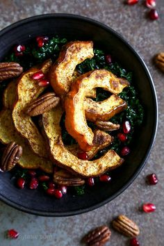 Roasted winter squash, pomegranates and pecans over massaged kale with a light maple balsamic dressing – there is nothing boring about this salad! Rubbing the raw kale with olive oil for a few minutes leaves it tender and takes away the bitterness. Kale Salad, Soup And Salad, Squash Salad, Whole 30 Recipes, Fall Recipes, Dinner Recipes, Healthy Salad Recipes, Vegetarian Recipes, Healthy Meals