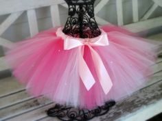Since I now have this tutu pattern and discovered I could do the whole thing in and hour and 15 minutes, I'm now just looking at ideas for tutus to make the g-babies, and as props for photos. I like this with the black lacey leotard, but I think I'd use the black rhinestone.