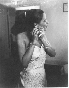 Billie Holiday was known for her bold presence, her tall physical stature. She emphasized this by wearing clothes that transfixed audiences in understated, purposeful ways. She loved a beautiful gown and accessorizing it perfectly.