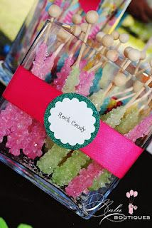 rainbow colored sweet shop birthday party dessert table pastel pink green rock candy