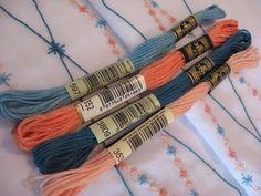 Diamond pattern pillowcases embroidered using DMC floss 597, 352, 3809, 353