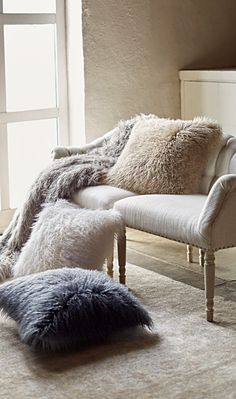 The Faux Mongolian Sheepskin Throw offers a chic take on faux fur in high-fashion hues. Plush fibers produce a high pile with fluffy softness, enlivening a living space with textural warmth.
