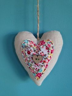 A personal favourite from my Etsy shop https://www.etsy.com/uk/listing/466737217/shabby-chic-heart-and-driftwood-hanging