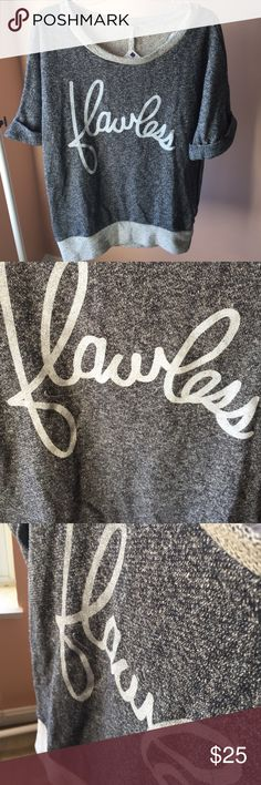 "Oversized ""Flawless"" Gray 3/4 Length Sweater Oversized sweater with three-quarter length roll up sleeves. The word Flawless in script.  Brand-new with tags.  Materials:  60% cotton  40% polyester Impressions Boutique Sweaters Crew & Scoop Necks"