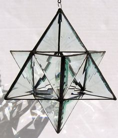 The Star of David, also known as known as the Magen David or the Shield of David, is the emblem of the Jews. This one is created with hand crafted bevels and measures 8 X 10 inch Let the light shine in - the slanted edges of the bevels refract light into a rainbow of colors. • Perfect religious keepsake for friends and family  Experts also say that the top triangle of the star represents the upward direction towards God, and the lower triangle symbolizes the real world that exists below…