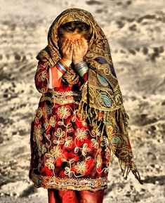 Camera shy Afghan girl.   (Flickr: Island-life)