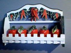 CHILI PEPPER Spice Rack & 3-D Jars -Beautiful BRAND NEW . $29.25. Excellent attention to detail and such vibrant colors!. Great as a gift!. Keep your kitchen organized while also adding style!. Perfect for ANY chili pepper collector!. Create a personal and elegant touch to your kitchen!. Hot Chili Pepper Spice Rack. This spice rack has a beautiful design of Chili Peppers! The rack itself is made of wood with painted Chili Peppers covering the top. Rack is trim...