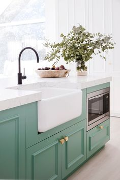 Having created a green kitchen in their latest whole home reno, Lana Taylor of Three Birds Renovations reveals her tips for embracing bright hues in Kitchen Dining, Kitchen Decor, Kitchen Cabinets, White Cabinets, Butler Sink Kitchen, Pink Kitchen Appliances, Colored Cabinets, White Counters, Green Cabinets