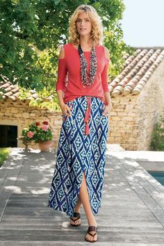 "Start your day on island time. This skirt's batik-style diamond print ripples like water on light crinkled gauze, accented with a sun-coral pop of color at the beaded tassel drawstring belt and embroidered pockets. Back elastic waist. Rayon. Misses 38"" long. Sits at natural waist. Java Maxi Skirt #2AL35"