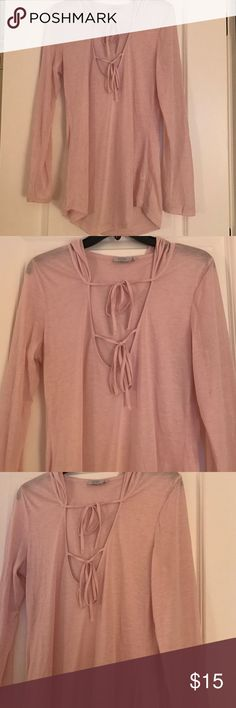 Pink long sleeve hooded tie blouse Long sleeve blouse from Tobi! Tied on the chest with a hood. So cute with ripped jeans or shorts, and with a cool bandeau. Never worn! Tobi Tops Blouses