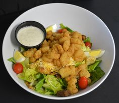 Southern Fried Salad. Popcorn Shrimp over tossed greens with tomatoes and cheddar cheese. Served with Joe and Dave's honey-mustard peppercorn dressing!