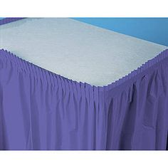 Transform the look of any table with the  Purple Plastic Table Skirt. Each of the 29 inch high x 12 feet long purple plastic table skirts has an adhesive backing for easy hanging.